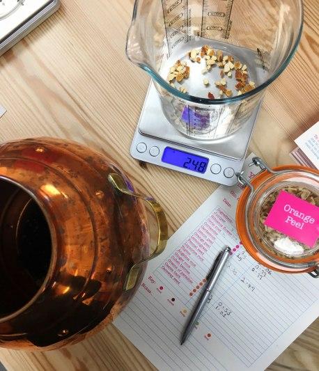 gin botanicals being measured
