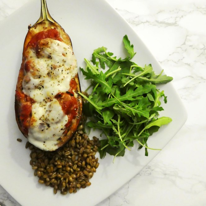 Stuffed aubergine with rocket and freekeh